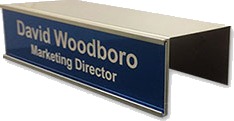 Office nameplate holders for cubicles easily slide over any cubicle wall, and slide in a nameplate. Many colors available in durable metal that can be moved and reused over and over. NapNameplates.com