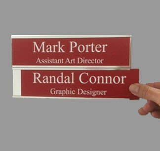 Double nameplate holder for doors and walls holds 2 standard nameplates. Durable metal is scratch resistant and allows you to easily slide in 2 metal or plastic nameplates. NapNameplates.com